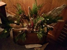 Driftwood, evergreens, and fairy lights in an old copper boiler. Made a beautiful display by our fireplace all winter long!