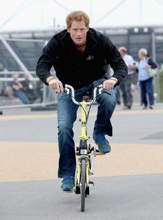 Radar Online | Prince Harry Is Cheered By A Member Of The Public As He Cycles Between Venues On His Brompton Bike At Queen Elizabeth Park