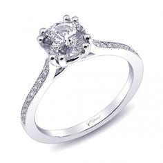 A beautiful, classic engagement ring with fine pave set diamonds and milgrain edging. Built to hold a 1CT center stone.