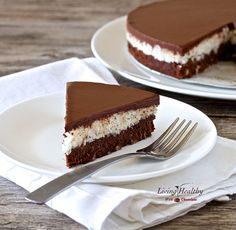 This paleo coconut chocolate cake recipe has three layers, super moist cake, creamy coconut topping layer and is covered with a dark, shiny chocolate glaze.