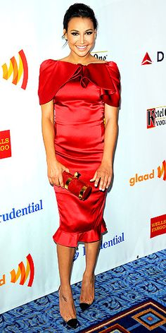 "NAYA RIVERA  Before auctioning off her ""sweet lady kisses"" for charity, GLAAD Media Awards's cohost heats things up in a red-hot ruffled Moschino number, Stark clutch and capped pointy-toe heels in N.Y.C."
