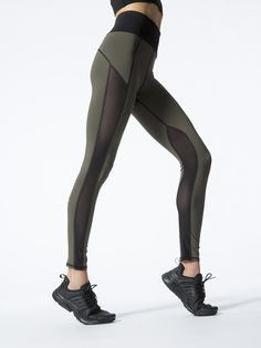 The Summit High Waisted Legging by Michi in olive is a high-waisted, full length legging that offers ventilation, silky stretch and high performance. Fine mesh panels line the legs in signature Michi fashion. Transition seamlessly from studio to street in