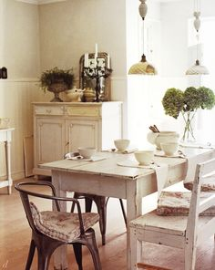 farmhouse dining: neutral palette, beadboard w/ lt. taupy/grey walls, white distressed furniture