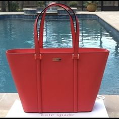 """NWT KATE SPADE NEWBURY LANE DALLY TOTE if you are interested I sell this bag at Mer.Car.i for lower price because there is no service fee there. Exterior: Saffiano Leather in Geranium Zip Closure 14 -karat plated hardware Strap drop is 9 1/2"""" Drop  Protective leather strip on bottom INTERIOR: Fabric lining in a cross hatched design in black and white 2 multi-functional pockets 1 large Security zip pocket Dimensions: 11.5"""" H x 13.5"""" Bottom 19"""" Top (Dimensions are approximate)  Tote is SIMPLE…"""