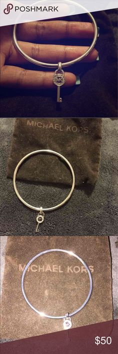 Michael Kors bangle 100% authentic  My wrist is tiny so this doesn't fit Never worn Brand new no scratches or anything  Comes with the little Michael kors jewelry pouch, which is pictured. Michael Kors Jewelry Bracelets