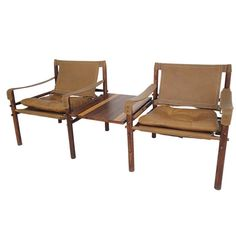 Arne Norell Rosewood Safari Lounge Chairs with Table | From a unique collection of antique and modern armchairs at https://www.1stdibs.com/furniture/seating/armchairs/
