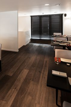 Project Zushi Bar - Z-parket - Floor: Paris. A stylish Zushi bar with a mixture of contemporary and classic design blended with dark Z-parket Paris floor. #zparket #architecture #oakhardwoodfloors #engineeredwoodfloors