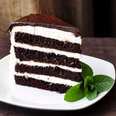 Midnight Mint Chocolate Cake - 4 layers of moist scratch cake and creamy mint frosting. A chocolate-mint lovers dream birthday cake.