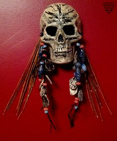 Another hand built clay skull wall hanging with  willow branches and hand made clay beads.