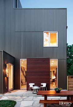 This house utilized a complete rain screen wall siding system using hidden fasteners, which created a sleek, clean finished product. Masarandubra Brazilian redwood was juxtaposed with a corrugated metal siding, using horizontal seams, or reveals, as an architectural element to break up the long spans. http://www.faustconstruction.com/