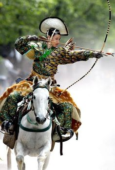 An archer dressed in traditional samurai garb displays Yabusame (archery while on horseback).