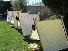 tents with toddler-friendly activities in each one: book station, water bead station, bubble station