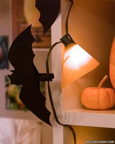 Spine-chilling as it sounds, a colony of bats hanging from the highest reaches of your house serve as the perfect welcome for guests -- if you're throwing a Halloween party.How to Make Clothespin BatsFind a Michaels Store Near You to Purchase Bat Silhouettes In-StorePurchase Bat Silhouettes From Martha Stewart Crafts