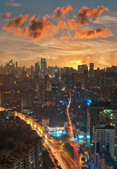 A Shanghai orange sunset with almost burning clouds above a colorized city.