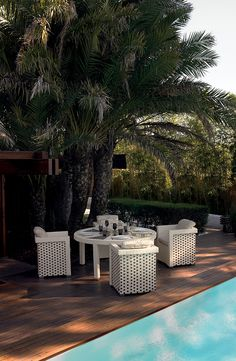 Nothing better than dining by the pool in a beautiful sunny day. Fendi Casa Outdoor collection give you the style for your garden. Luxury Living Group