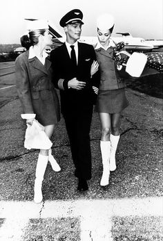 Carla Bruni and Meghan Douglas look trés chic posing as flight attendants in US Vogue.