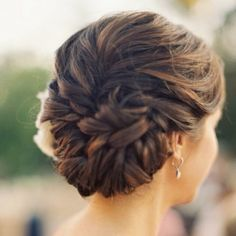 Classy and sophisticated updo that has a modern twist! Love this!