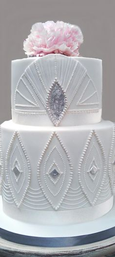 If a geometric decadent cake is what you're wanting for a wedding cake then go no further than this stunning art deco white wedding cake.