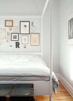You bet I love this. Simple 4 poster bed with clean lines? Frame and letter collage? Fresh and breezy paint color? Holla.