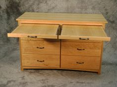 This cherry cabinet of drawers also features two pull-out surfaces to provide lots of utility and added surface area.