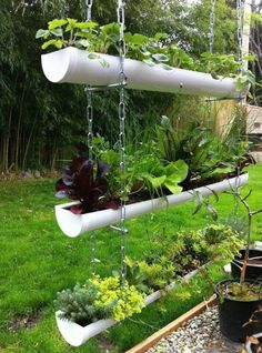 Designing and growing your herb garden in a gutter garden is fun and exciting no. Designing and growing your herb garden in a gutter garden is fun and exciting no matter how basic your DIY ability. A great vegetal wall is easy to create Garden Planters, Garden Art, Hanging Planters Outdoor, Diy Planters, Garden Kids, Garden Table, Hanging Baskets, Tyre Garden, Recycled Planters