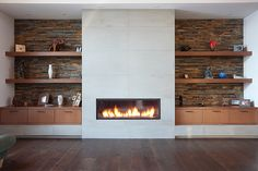 concrete tile fireplace and cabinets on the side