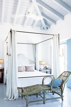 Light and airy white bedroom with blue floors via @thouswellblog