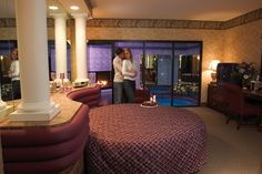 Enjoy a romantic weekend getaway in the Poconos with spacious luxury suites fitted with log burning fireplaces, whirlpool tubs & more at Cove Haven Resorts.