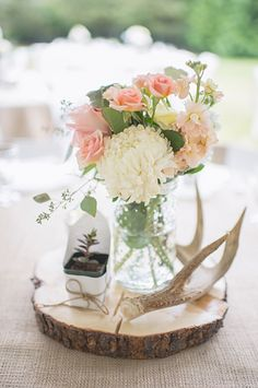 Simple country wedding centerpieces picture of a rustic wedding centerpiece with a wood slice a succulent antlers and pastel blooms simple country church Rustic Wedding Centerpieces, Diy Centerpieces, Wedding Decorations, Wedding Rustic, Antler Wedding Decor, Centerpiece Flowers, Wood Slab Centerpiece, Antler Centerpiece, Quinceanera Centerpieces