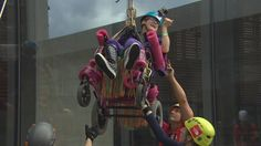Teen with cerebral palsy rappels down Winnipeg skyscraper in her wheelchair for charity #GratePic