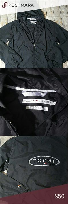 "SALE🌷Tommy Hilfiger Black Rain Jacket Tommy Hilfiger lightweight black full-zip rain jacket. 100% polyester. Size small, has a full zip, elastic lining, and a ""Tommy"" logo on the back. The logo is a little faded but otherwise the jacket is in great condition. Bundle up! All offers are welcome here in my closet! Tommy Hilfiger Jackets & Coats"