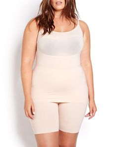 AVAILABLE ONLINE ONLY. Smooth your curves to bring out your gorgeous silhouette using the plus size shapewear products carried by Addition Elle, Spanx, which provides targeted shaping support. Featuring a lightweight feel that's perfect for layering, breathable, wicking, and absorbent materials for added comfort. Convertible, spaghetti straps.