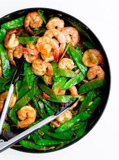 shrimp, snow pea + ginger stir fry w/ chicken broth, soy sauce, asian chile-garlic sauce, cornstarch, sesame oil, fresh ginger, garlic, scallions, snow peas, peeled, deveined, tail-on shrimp + lime juice, serve w/ sushi rice