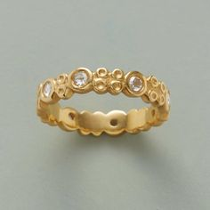 BED OF ROSES RING -- Anne Sportun celebrates love's special occasions—and our 20th anniversary—with this sparkling band, wrought in 14kt gold with a matte finish and set with eight rose cut diamonds. Handcrafted in Canada. Whole sizes 5 to 8.