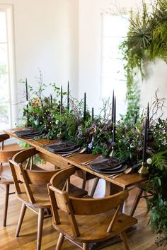 an edgy moody winter wedding table with evergreens, moody blooms, feathers, twigs and black candles and plates - Weddingomania Botanical Wedding, Floral Wedding, Rustic Wedding, Dress Wedding, Wedding Colors, Wedding Flowers, Wedding Hair, Casual Wedding, Woodland Wedding