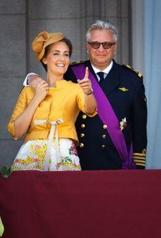 Prince Laurent and Princess Claire greet from the balcony of the Royal Palace in Brussels, Belgium, 21 July 2013, the country's National Day.