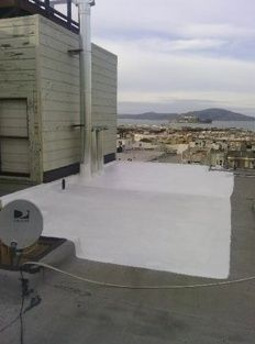 Flat roof repair in San Francisco North Beach District. We had to repair the corner section of roof and then put a cool coating over the top layer of the granular roof membrane, The view is pretty awesome as well.