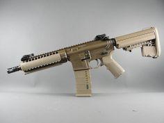 LWRC PSD 5.56mm in Patriot Brown Cerakote with Flat Dark Earth furniture.