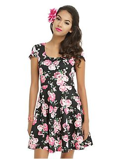 "<p>There's something about a skater dress that makes us want to twirl around in circles! Black skater dress with a pink, teal and green floral print and keyhole back detail. </p>  <ul> 	<li>93% polyester; 7% spandex</li> 	<li>Wash cold; dry low</li> 	<li>Model is wearing size small</li> 	<li>Approximately 34"" from shoulder to hem</li> 	<li>Made in USA</li> </ul>"