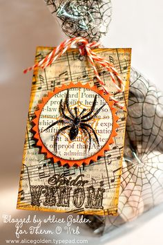 Halloween tag using plastic spider (snipped off of inexpensive spider ring). Easy to re-create for party favors