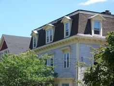 mansard roof: Type of roof having two slopes on every side, the lower slope being considerably steeper than the upper.