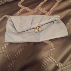 BCBG light blue clutch Used only a couple of times. Looks brand new. Pretty soft blue color with gold on balls. BCBG Bags Clutches & Wristlets