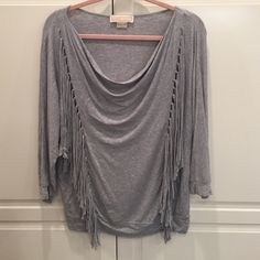 Michael Kors cowl neck gray fringe top Michael Kors gray fringe top with cowl neck. Fringe is on the front and the back. Super cute with leggings! MICHAEL Michael Kors Tops