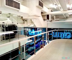 The Industrial vibe An exposed ceiling, neon lights, metal stairs and mezzanine balcony – it is a retail space styled in an industrial décor. Metal Stairs, Fashion Brand, Fashion Design, Retail Space, Neon Lighting, Brand Design, Interiors, Home Decor, Style