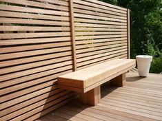Maybe skip a real back to bench: Iroko screen, deck & bench but in an L for the corner?