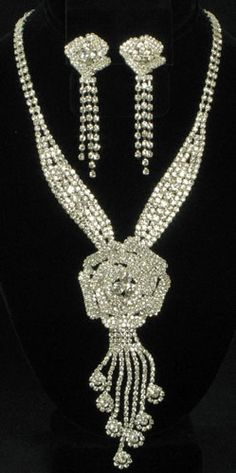 Modern Clear Rhinestone Flower Necklace with CLIP ON Earrings Accented in Silvertones @ www.whimzaccessories.com  $58