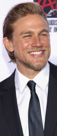 Charlie Hunnam...that smile and those eyes makes my body quiver