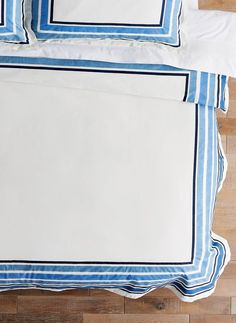A hand screen-printed watercolor border in eye-catching stripes sets this relaxed bedding collection apart. Crafted from 100% cotton.