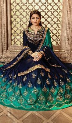 Be the sunshine of anyone's eyes dressed in this green and navy blue color georgette designer lehenga style suit. It has been beautifully designed with embroidered work. Long Choli Lehenga, Lehenga Choli Online, Anarkali Lehenga, Choli Dress, Indian Gowns Dresses, Pakistani Dresses, Indian Designer Outfits, Designer Dresses, Ethnic Fashion