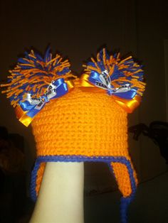 "double pom pom ear flap hat (in your team colors) with 2 - 5"" matching bows. 3pc set. $20.00, via Etsy."